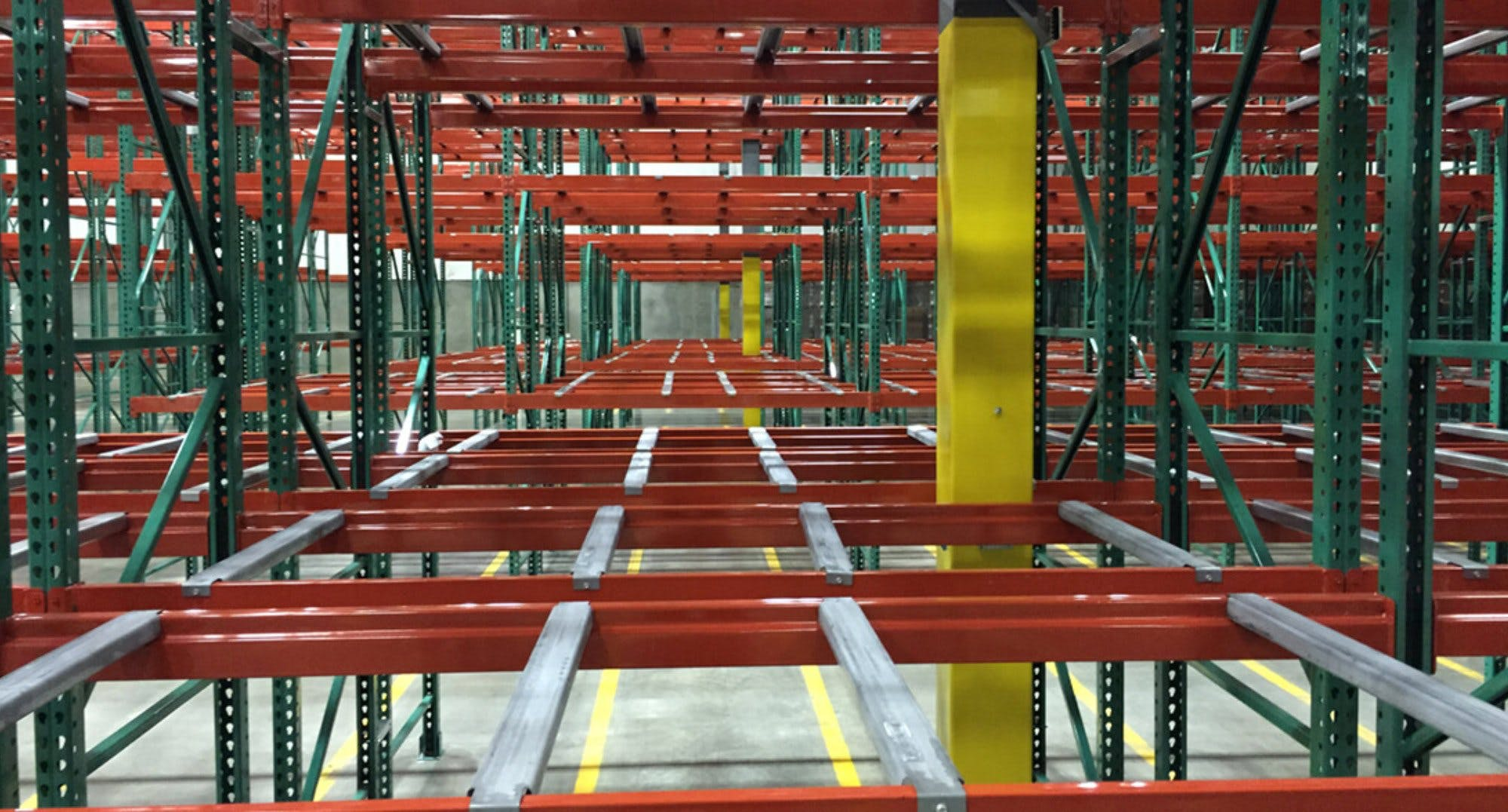 looking through red and green Space Rak storage in distribution facility card