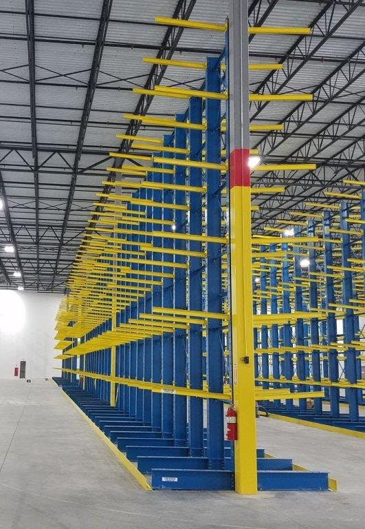 blue and yellow cantilever racking to store lumber in construction warehouse card